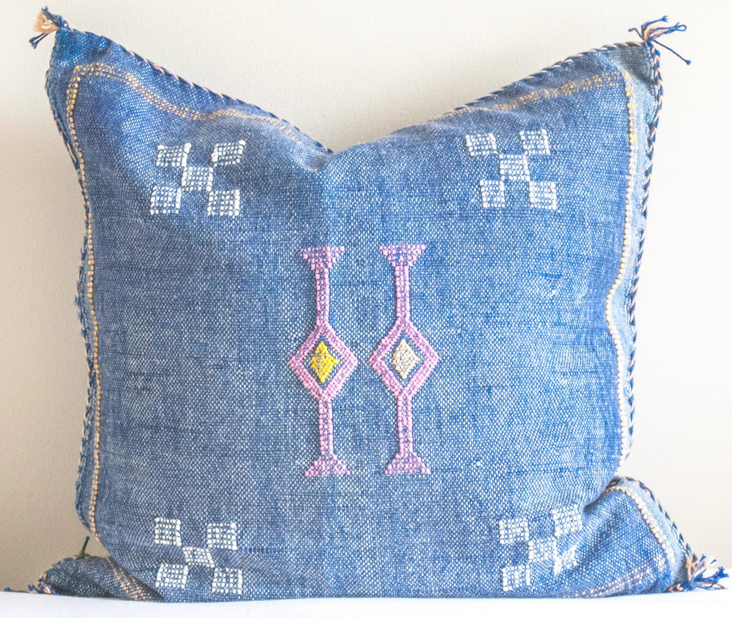blue moroccan pillow made with cactus silk or sabra silk with Moroccan motifs and colors blue, pink, yellow and white