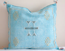 Load image into Gallery viewer, Moroccan pillows in washed turquoise 18x18 size with Moroccan motifs and accents in yellow, white and orange, tassels on each end