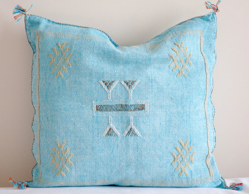 Moroccan pillows in washed turquoise 18x18 size with Moroccan motifs and accents in yellow, white and orange, tassels on each end