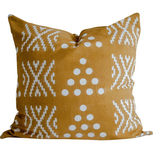 mustard pillow with hand block printed motifs in white