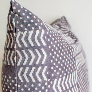gray throw pillow with white motifs and zipper close 24x24 size