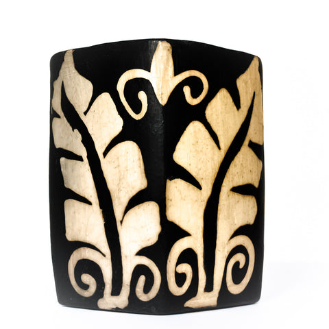 black and cream Lenca pottery accent vase with a leaf design