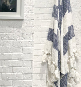 Designer striped throw in navy blue with tassels