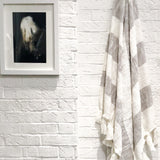 Designer striped throw in light gray with tassels