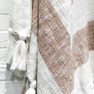 striped camel and white throw with tassels