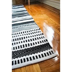 striped black and white area rug handmade in India with a modern design