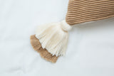 designer lumbar camel pillow with tassels