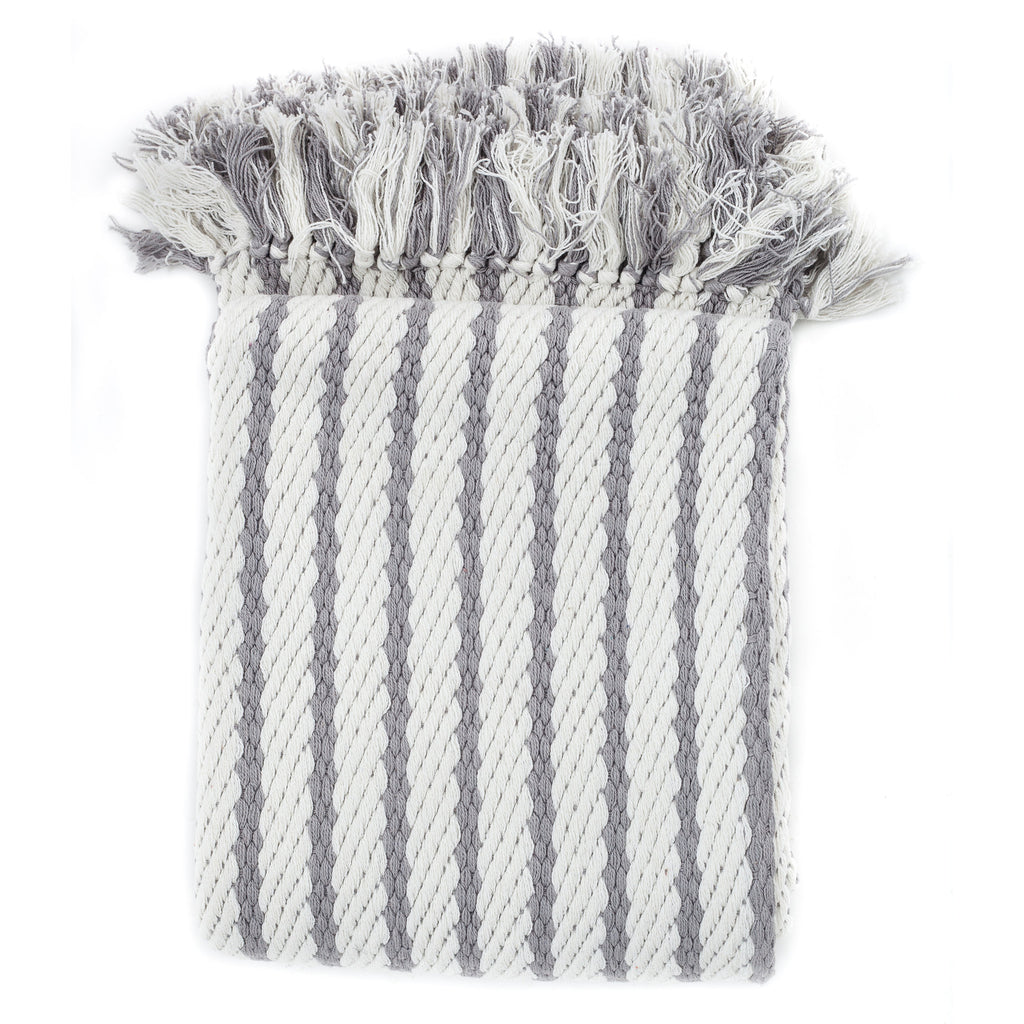 Light gray striped accent throw with fringe and a modern design