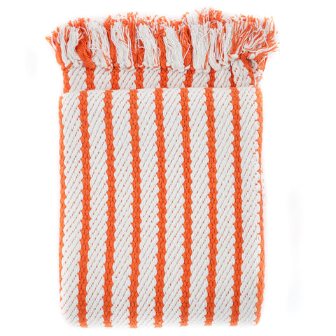 striped orange accent throw with fringe and a modern design