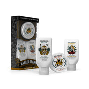 (Product image): Marked for life tattoo kit contents out of box. 3oz bottle of Fresh tattoo wash, 3oz bottle of Vibrant tattoo lotion, and 2oz jar of Defined tattoo salve.