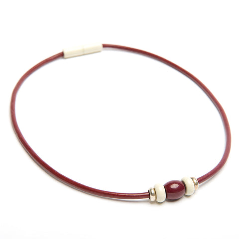 Magnet choker necklace in maroon with white and silver accents by Landella Jewelry store in Tulsa at The Boxyard