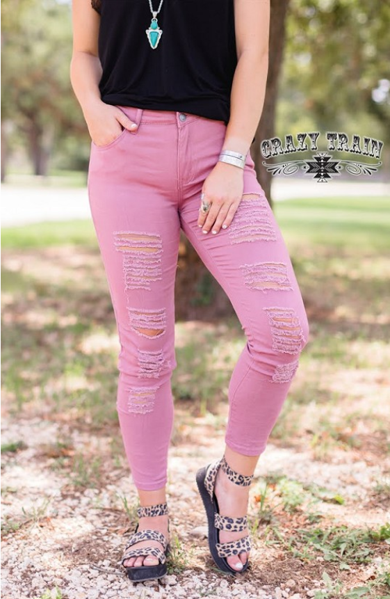 Distressed Mauve Skinnies