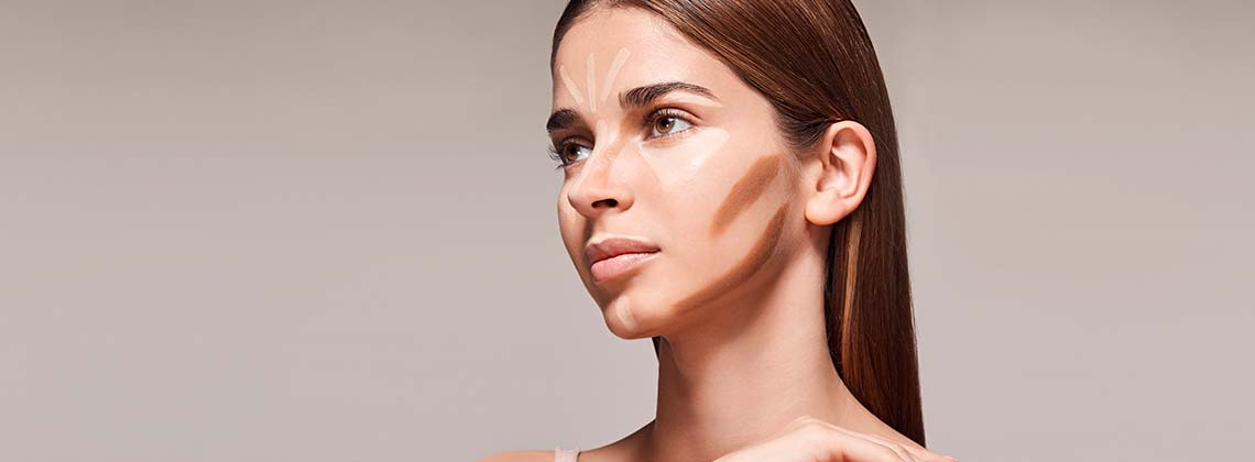 Model with foundation and primers on, getting ready to blend