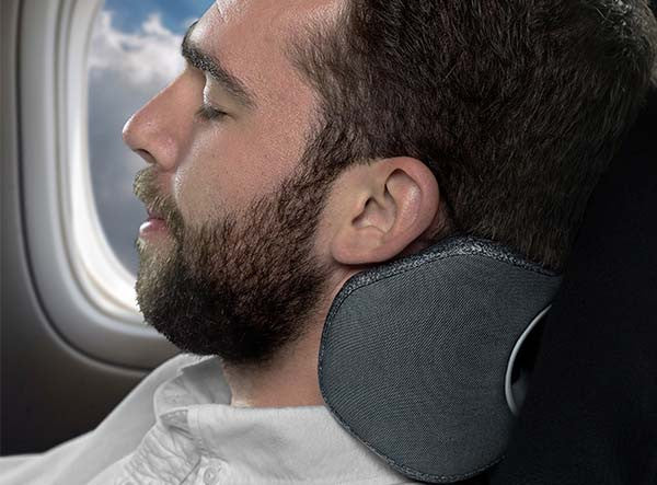 Man Using The BullRest Memory Foam Travel Pillow