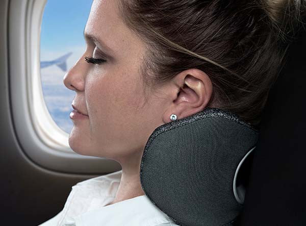 Woman Using The BullRest Memory Foam Travel Pillow