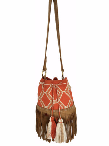 Image of Wayuu bucket bag purse with brown leather strap and fringe; bag is orange base with white and light brown detail