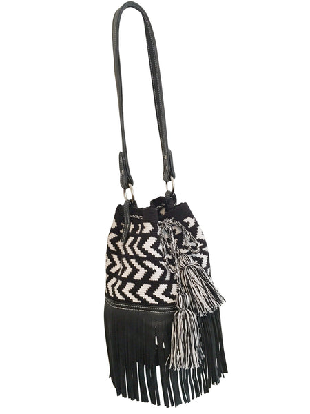 Image of Wayuu mochila purse with black leather strap and fringe; bag is black base with white arrowhead pattern