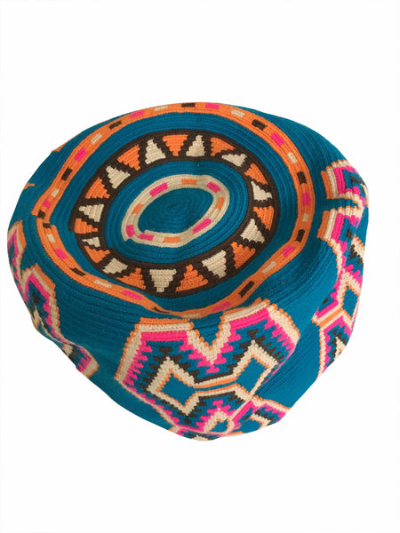 Image of bottom of Wayuu mochila purse, drawstring crossbody bag with tassels and cloth strap; blue base with bright pink, chocolate brown, orange, tan design