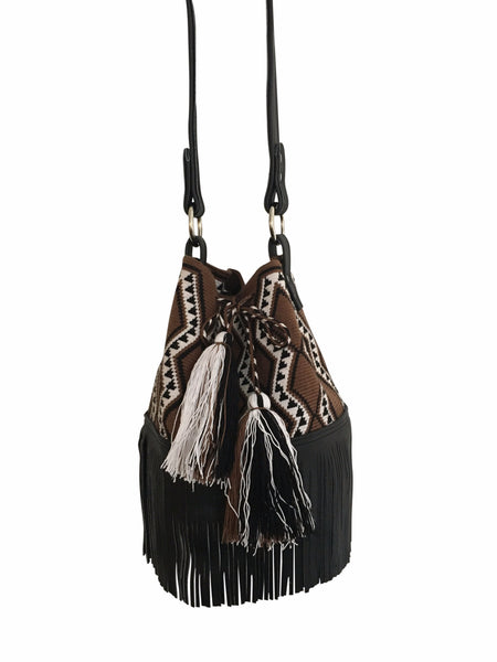 Image of Wayuu mochila purse with black leather strap and fringe; bag is chocolate brown with white and black pattern