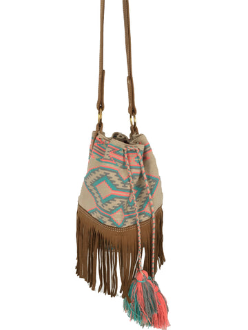 Image of Wayuu bucket bag purse with brown leather strap and fringe; bag is tan with soft blue, gray and pink