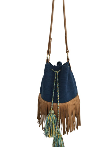 Image of Wayuu bucket bag purse with brown leather strap and fringe; bag is solid navy with colored tassels and drawstring