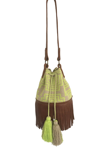Image of Wayuu bucket bag purse with brown leather strap and fringe; bag is light tan with neon yellow design