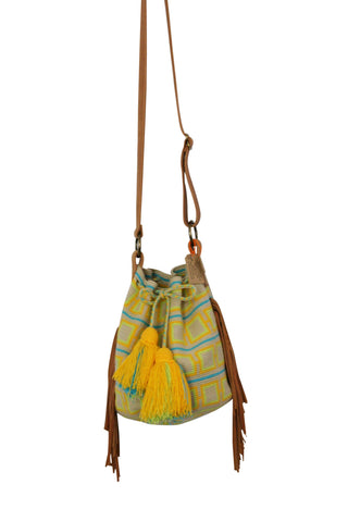 Image of one strand Wayuu bucket bag purse with brown leather strap and fringe and tassels; bag is light tan with bright yellow and orange squares and blue lines