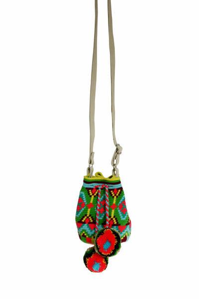 Image of Wayuu mini mochila bucket bag purse with adjustable leather strap, drawstring and two pompoms; bag has geo pattern and bright colors