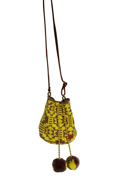 Image of Wayuu mini mochila bucket bag purse with adjustable leather strap, drawstring and two pompoms; bag has brown base with bright yellow design