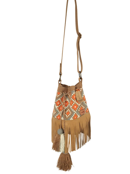 Image of Wayuu bucket bag purse with brown adjustable leather strap and fringe and tassels; bag is tan with orange, white and blue design