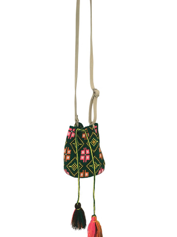 Image of Wayuu mini mochila bucket bag purse with adjustable leather strap, drawstring and two tassels; bag has geo patterns with multi colors on green base