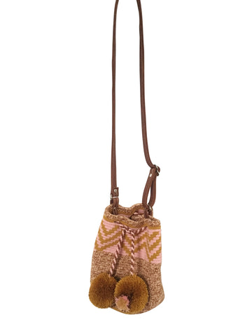 Image of Wayuu mini mochila bucket bag purse with adjustable leather strap, drawstring and two pompoms; bag has zigzag lines top on neutral base