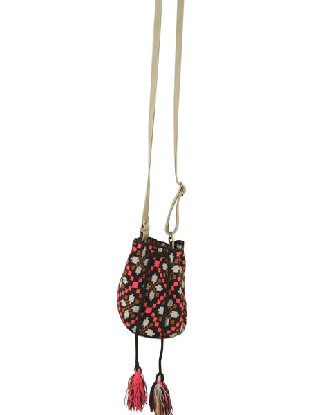 Image of Wayuu mini mochila bucket bag purse with adjustable leather strap, drawstring and two tassels; bag has geo patterns with multi colors on brown bag