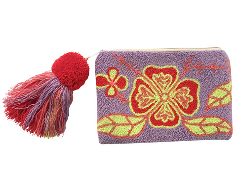Image of Wayuu tapizado small clutch purse with pom pom tassel; rectangular shape colored light purple, red, pink, bright yellow