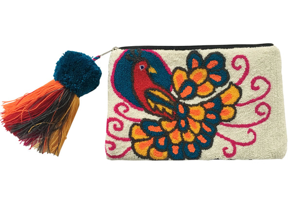 Image of Wayuu tapizado small clutch purse with pom pom tassel; rectangular shape colored white with multi colored peacock design