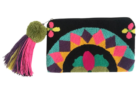 Image of Wayuu tapizado small clutch purse with pom pom tassel; rectangular shape colored black, bright pink, turquiose, gold, green, magenta, bright yellow