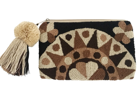 Image of Wayuu tapizado small clutch purse with pompom tassel; rectangular shape colored a mix of neutral browns