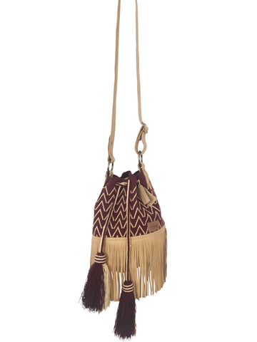 Image of Wayuu bucket bag purse with brown leather strap and fringe and tassels; bag is burgundy with light tan detail