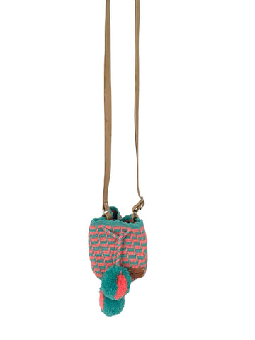 Image of Wayuu mini mochila bucket bag purse with adjustable leather strap, drawstring and two pompoms; bag has coral and teal rectangular design