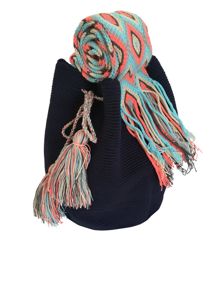 Side angle image of two strand Wayuu mochila bag, drawstring crossbody bag with tassels - base color navy blue with colorful strap