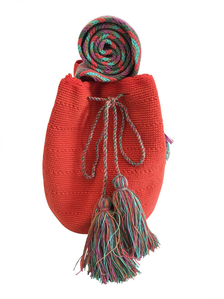 Image of two strand Wayuu mochila bag, drawstring crossbody bag with tassels - base color coral with colorful strap