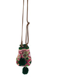 Image of Wayuu mini mochila bucket bag purse with adjustable leather strap, drawstring and two pompoms; bag has geo patterns with multi colors