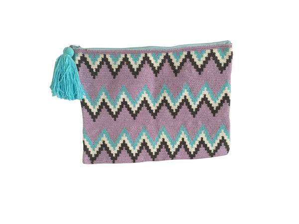 Image of Wayuu tejido large clutch purse with tassel; rectangular shape colored light purple base with light blue, white, dark grey, zig zags across bag