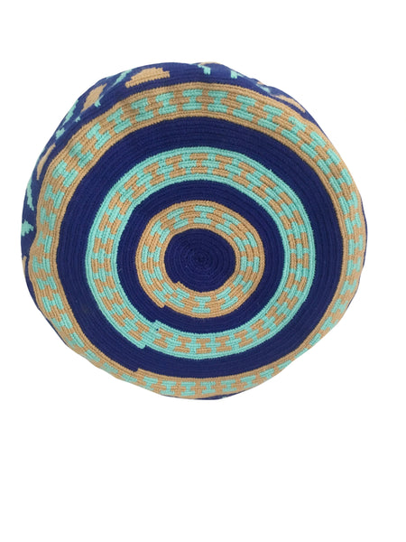 Image of bottom of Wayuu mochila purse, drawstring crossbody bag with tassels and cloth strap; royal blue base with light blue and tan design