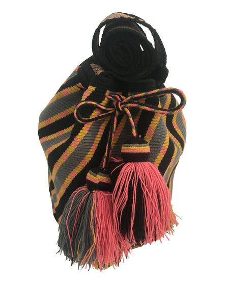Image of Wayuu mochila purse, drawstring crossbody bag with tassels and cloth strap; black base with diagonal design, pink, yellow and grey colors