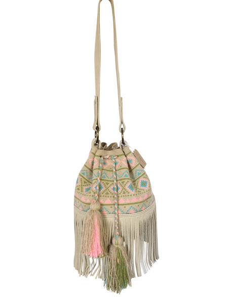 Image of Wayuu bucket bag purse with oatmeal colored leather strap and fringe with tassels; bag is neutral base with pastel color design