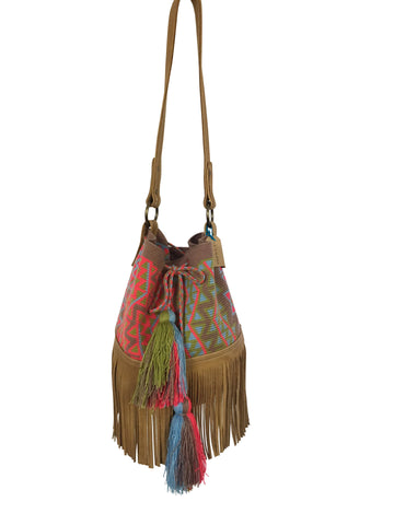 Image of Wayuu bucket bag purse with brown leather strap and fringe and tassels; bag is grey base with bright red, light green and blue design