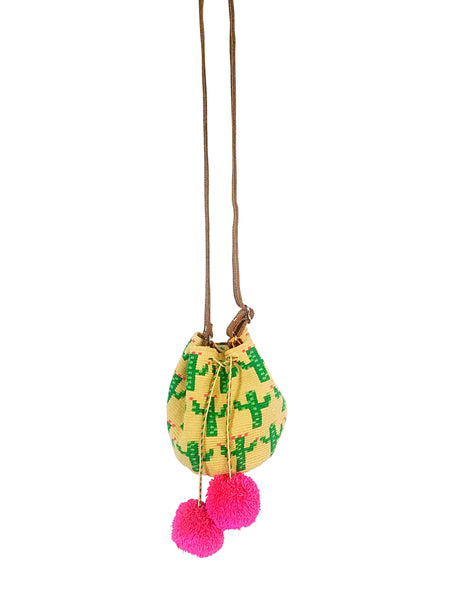 Image of Wayuu mini mochila bucket bag purse with adjustable leather strap, drawstring and two pompoms; bag has green cactus design