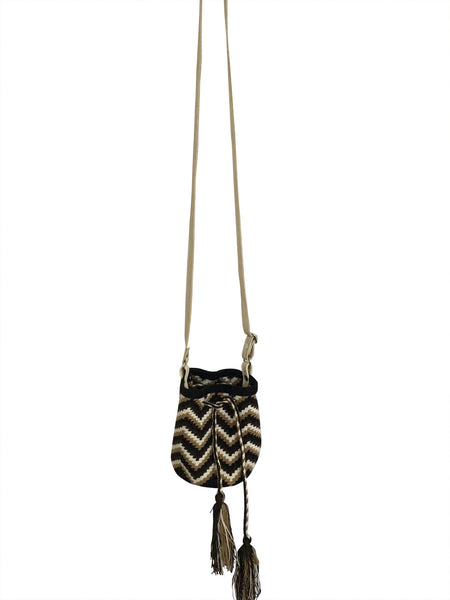 Image of Wayuu mini mochila bucket bag purse with adjustable leather strap, drawstring and two tassels; bag is dark brown, black, neutral zig zag design