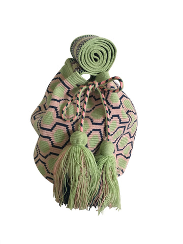 Close up image of una hebra Wayuu mochila purse, drawstring crossbody bag with tassels - base color light green with navy and light pink sextagon design